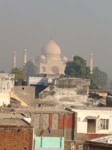 The Taj Mahal through the haze from the hotel roof top.